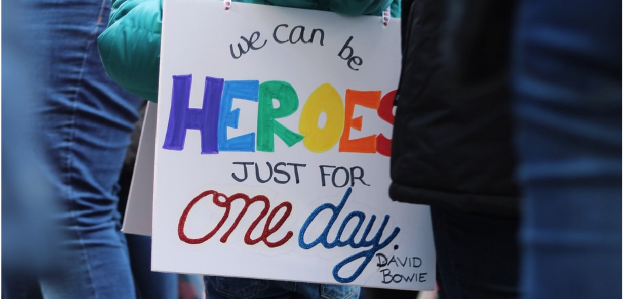 Board saying, we can be heroes, just for one day. David Bowie.