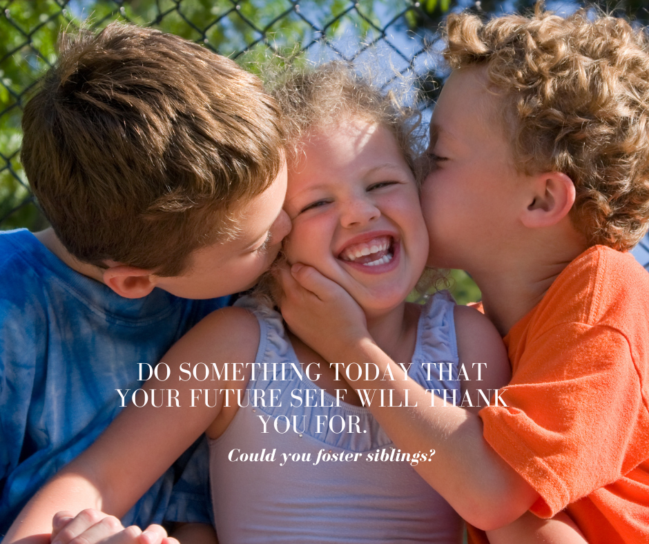 Three children smiling and kissing each other looking happy
