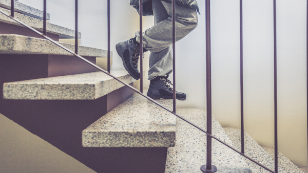 image of a child's legs walking down some stairs.